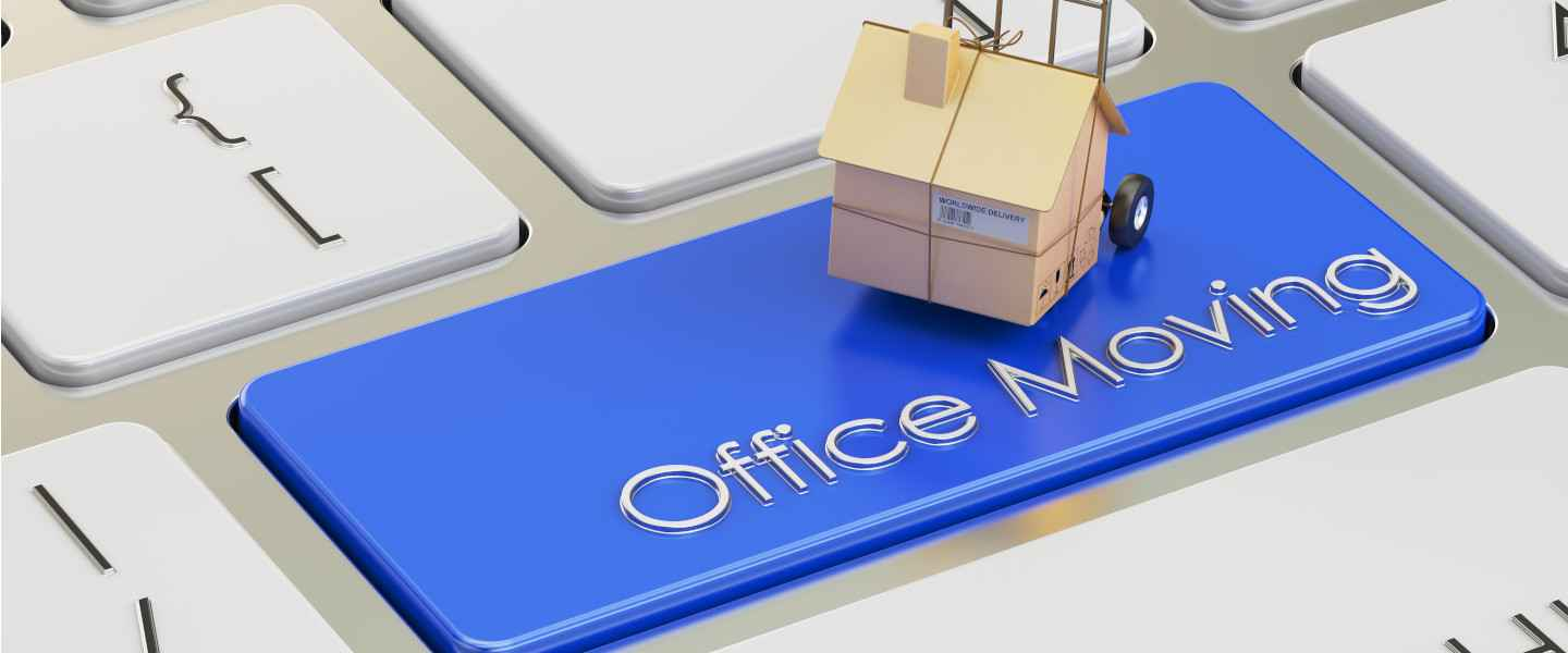 Miniature house on keyboard key labeled office moving